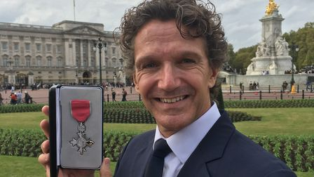 Gary Avis with his MBE in front of Buckingham Palace Picture: TIM HOLDER