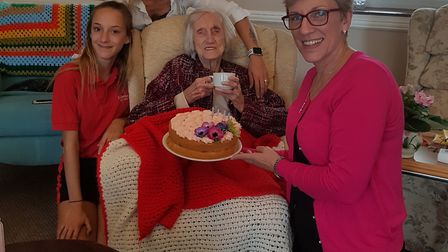 Enid on her birthday with her family and Sue Oates, manager of Barking Hall Picture: HEALTHCARE HOME