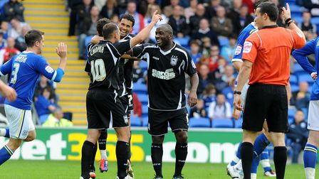 Jason Scotland celebrates with Michael Chopra at Cardiff on this day in 2011