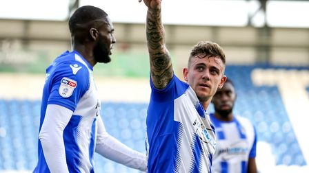 Sammie Szmodics acknowledges the fans after putting the U's into a 1-0 lead. He is congratulated by
