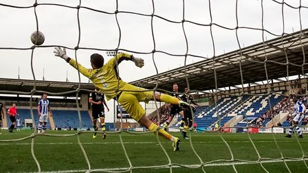 Frank Nouble beats Crawley Town keeper Glenn Morris to score the U's second in the U's 3-1 win. Pic