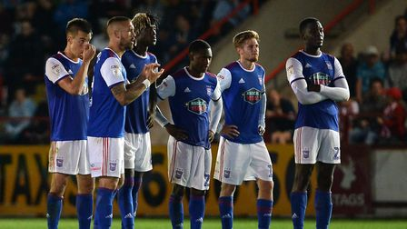 The Ipswich team watch the shoot-out at Exeter which they lost and boss Paul Hurst was not impressed