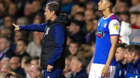 Andre Dozzell waits to come on against Middlesbrough, as Town manager Paul Hurst gives instruction.