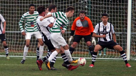 Fram's Levi Chapman's shot is blocked by the Long Melford defence. Photo: DEAN WARNER