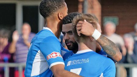 Seb Dunbar, centre, celebrates Byron Lawrence's goal with Lawrence, right and Noel Aitkens Photo: PA