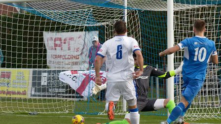 Reed in a rush! Jake Reed watches his shot beat the Halesowen keeper after just 14 seconds on Saturd