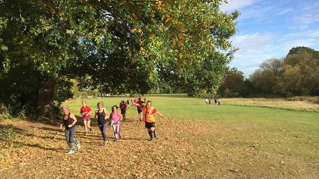 Runners tackling the traditional 5K course at Chantry Park in Ipswich on a warm Saturday morning. Pi