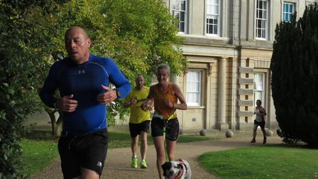 Runners and dogs stride out around the Ipswich parkrun route in Chantry Park. Picture: IPSWICH PARKR
