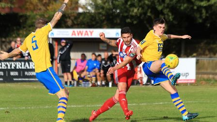 Seasiders' Jack Ainsley (red) shoots just wide under pressure fro Sudbury's Tommy Dettmar Photo: STA