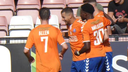 Mo Bettamer (second left) congratulated after scoring a goal for Braintree, in the 1-1 draw aainst B