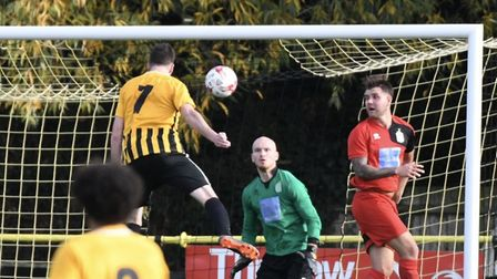 Stow's Ollie Canfer gets in a header against Harpenden Photo: DAVID WALKER