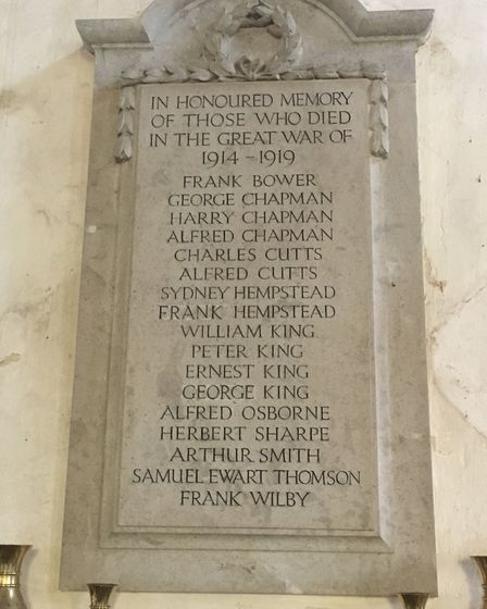 The plaque of 17 of the soldiers from Stradishall who died in action during World War one at Stradis