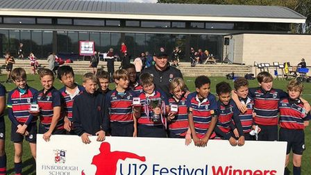The under-12 winners with England star Dylan Hartley at the Finborough School rugby festival. Pictur