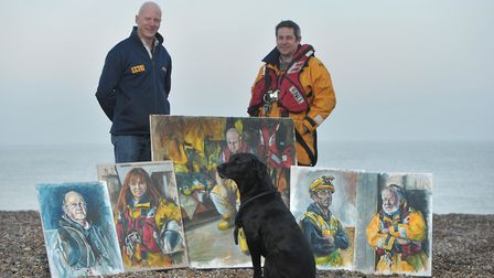 Coxswain Steve Saint, his dog George and David Gillingwater with some of the paintings Picture: