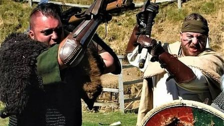 Standing shoulder to shoulder in the shield wall will be a number of fierce re-enactment groups Pict