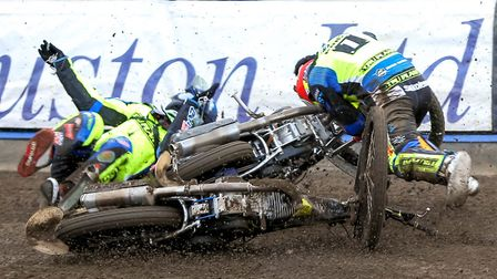 Michael Hartel (left) and team-mate Danny King tumble among their machinery after crashing. King suf