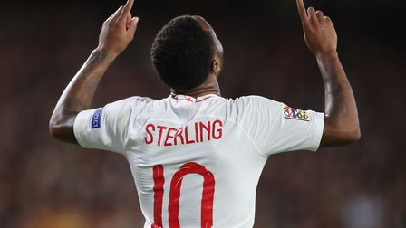 Raheem Sterling celebrates scoring his side's first goal of the game during the Nations League match