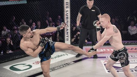 Ollie Sarwa, right, fights for the bantamweight title in Colchester. Picture: BRETT KING