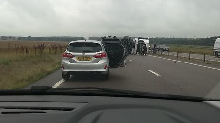 A lorry that overturned on the A11 has damaged 300 metres of central reservation that need to be rep