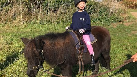 Jasmine Nightingale pictured during a pony riding lesson Picture: JULIE NIGHTINGALE
