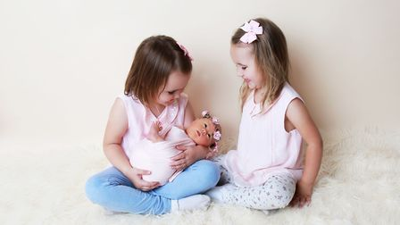 Baby Willow with her older sisters Aria and Elaina Picture: LIANNE MARIE PHOTOGRAPHY