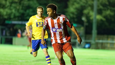 Rhys Henry (in red) in fine form against AFC Sudbury in Velocity Trophy Photo: STAN BASTON