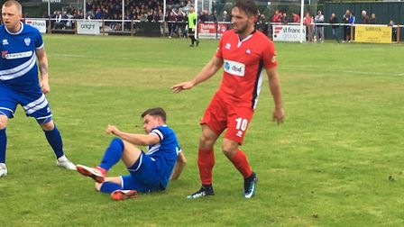 Brantham captain Ed Nobbs (grounded) and Craig Hughes in the thick of the action against Eastbourne