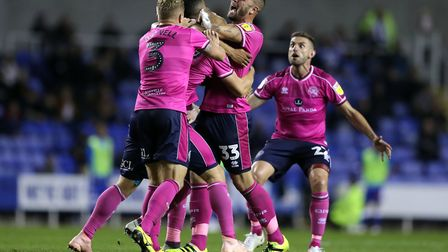 Toni Leistner (second left) celebrates his winner for QPR at Reading at the start of this month. Pho