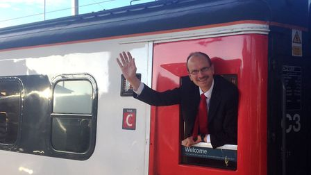 Sandy Martin sets off by train for his first day at Westminster - now he is calling for Ipswich trav