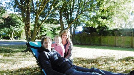 Suffolk couple Jonathan and Jenny Davies, and grandaugher Lily, with their new product - a rucksack