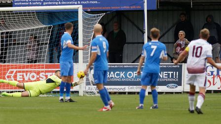 Leiston 'keeper Marcus Garnham makes one of a string of fine saves to keep his side in the tie again