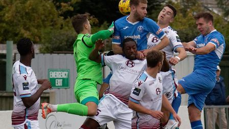 Leiston's Joe Jefford, right, climbs highest to head home to make it 1-1 at Victory Road Photo: PAUL