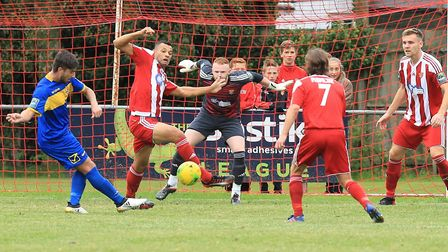 Taylor Tombides snatches a goal back for Romford as Felixstowe's Dan Davis tries to block Photo: STA