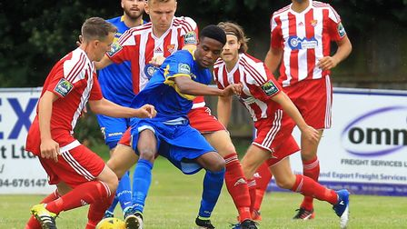 No way through for Romford's Jonathan Nzengo as he is surrounded by Felixstowe defenders Photo: STAN