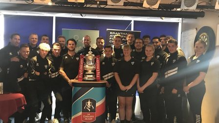 Brantham Athletic's playing squad and staff with the FA Cup trophy. Picture: BRANTHAM ATHLETIC TWITT