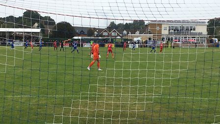 The scene at Brantham Athletic on Saturday, as viewed through one of the goal-nets, during the FA Cu