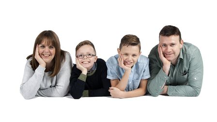 Hayley Adams with her husband Duane and their two boys Elliot (left) and Seb . Hayley died from a bl