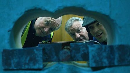 Peering through the hole in the wall in The King of Thieves. Picture: STUDIOCANAL
