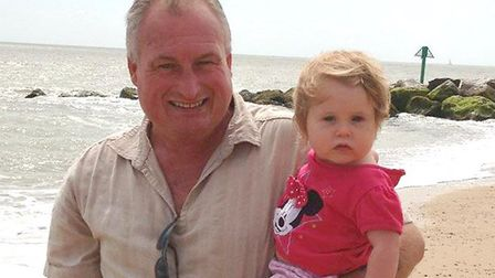 Alan Burgess, pictured on the beach with his granddaughter Picture: FACEBOOK