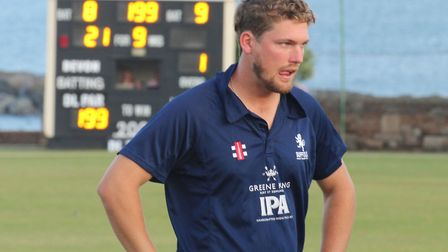 Ben Shepperson looks crestfallen as the Sidmouth scoreboard shows that Suffolk and Devon have both s