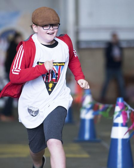 An athlete competes in the 100-yard run at the 37th Joan Mann Special Sports Day at RAF Mildenhall P