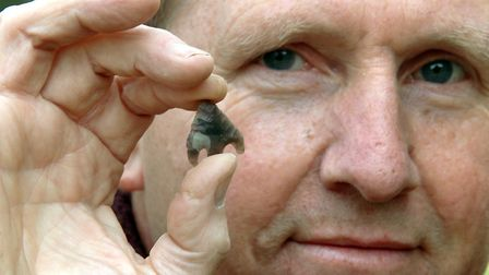 Builder Alan Parish in 2009 with the Bronze Age arrowhead he found by a stream while working on a pr