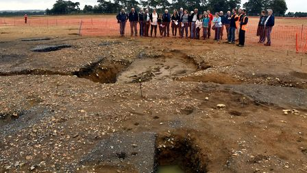 Visitors in 2016 tour a major archaeological excavation between the Mildenhall Estate on the outskir