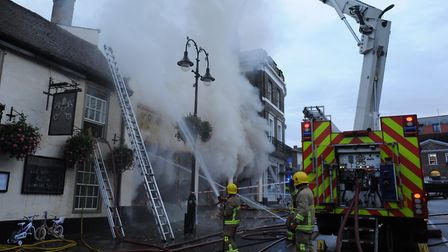 Firefighters tackle the serious fire at the Cycle King shop on Angel Hill in Bury St Edmunds Picture