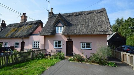This thatched cottage in Stoke By Clare has a guide price of £245,000 from David Burr. Picture: DAVI