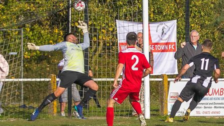 Ryan Keeble finishes of a fantastic move from Woodbridge to score against Godmanchester. Photo: PAUL