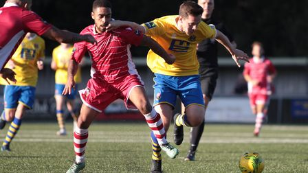 Darryl Coakley, right, battles for the ball against Egham Photo: CLIVE PEARSON