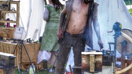 A blacksmith works away at his forge Picture: BARRY PULLEN