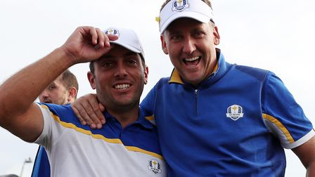 Team Europe's Francesco Molinari and Team Europe's Ian Poulter celebrate winning the Ryder Cup Photo