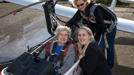 99-year-old Olwyn Hopkins with Davers Court lifestyle coordinator Katie Ramsbotham and pilot Liz Rus